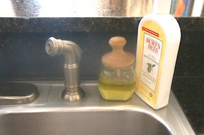 sink with hand scrub honey jar